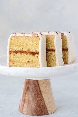 Load image into Gallery viewer, 3 slices gluten free almond pound cake with marzipan on cake stand