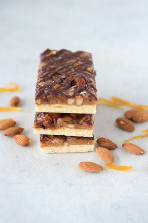 Load image into Gallery viewer, stack of 3 gluten free florentine bars pictured with almonds and candied lemon