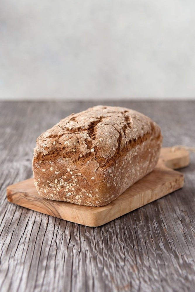 Load image into Gallery viewer, whole loaf gluten free Hype bread on wood board