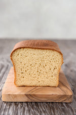 cut face view gluten free Spring Bread on wood board, white sandwich bread, dairy-free