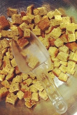 gluten free croutons in metal bowl with scoop
