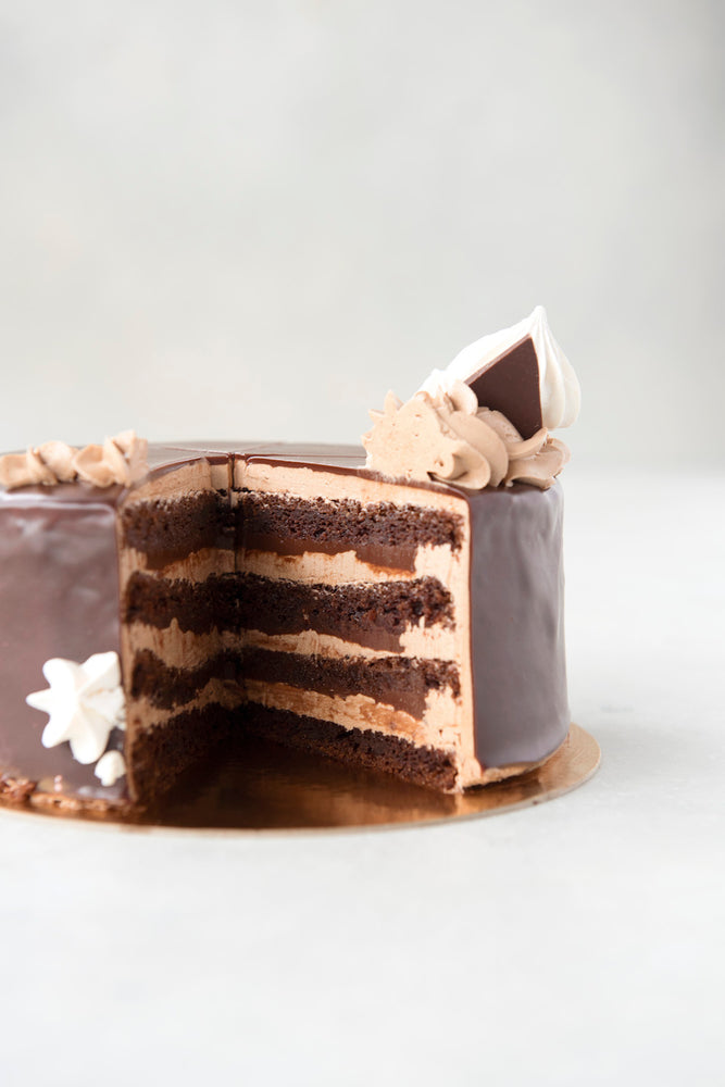 Load image into Gallery viewer, cut inside view gluten free triple chocolate cake with ganache and chocolate buttercream
