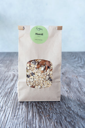Load image into Gallery viewer, 500g gluten free muesli with almonds, dried cranberries in paper window tin tie bag and Origin Bakery sticker