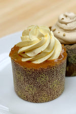 gluten free sponge cupcake topped with orange caramel and piped orange buttercream swirl