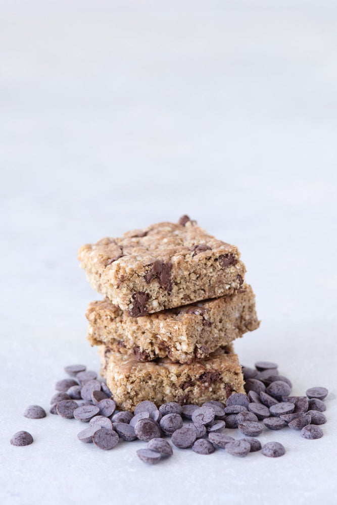stack of 3 gluten free vegan chocolate chip cookie bars shown with Michel Cluizel soy-free dark chocolate chips