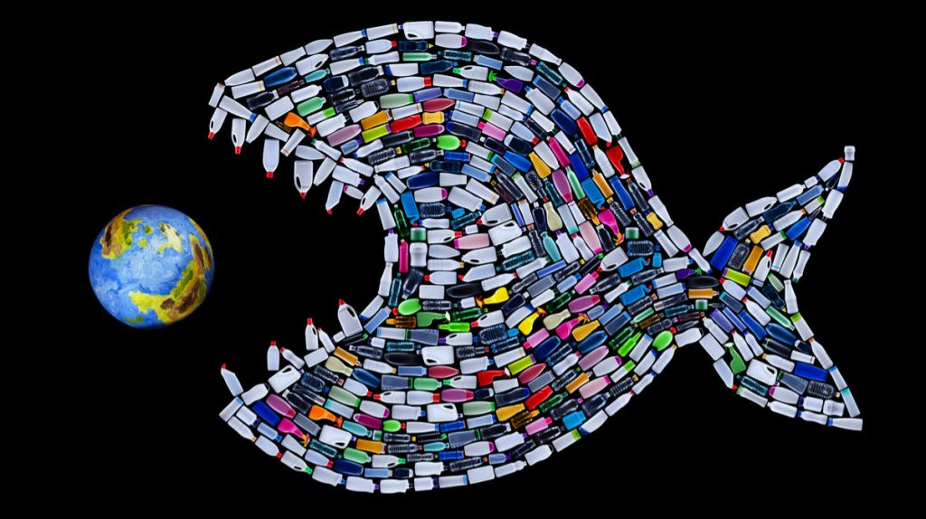 Plastic Fish Eating Earth Concept