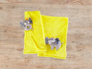 Zoocchini Baby Blanket keeps your baby warm with an included toy