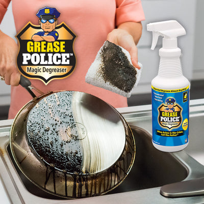 A bottle of Grease Police, A woman holding a greasy pan in the background upside down with half of the grease wiped off with a cloth she is holding, Brand logo with product name in top left corner