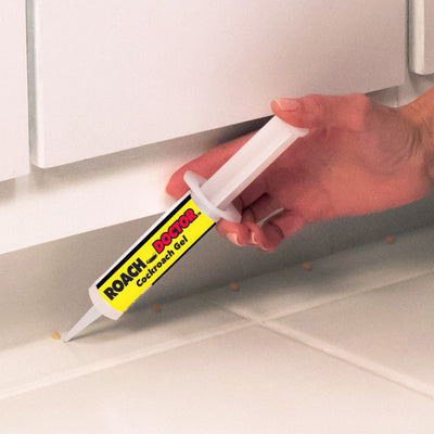 Applying Roach Doctor under cabinets