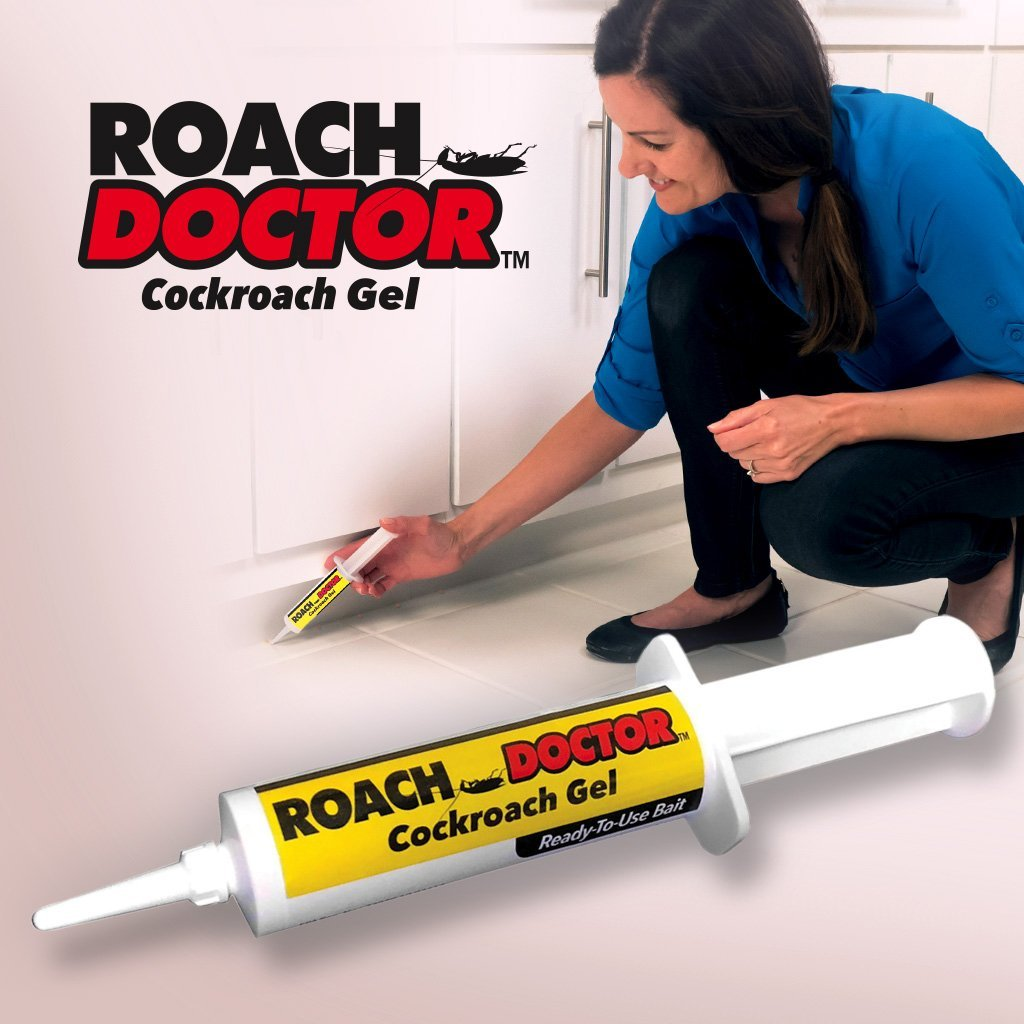 Woman applying Roach Doctor under cabinets
