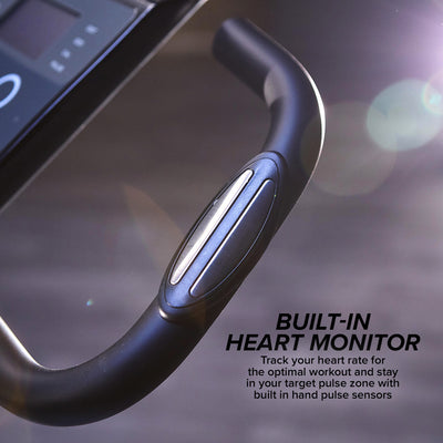 "Showing built-in heart monitor on the handle of the Slim Cycle, includes text ""Built-In Heart Monitor"", ""Track your heart rate for the optimal workout and stay in your target pulse zone with built in hand pulse sensors"""