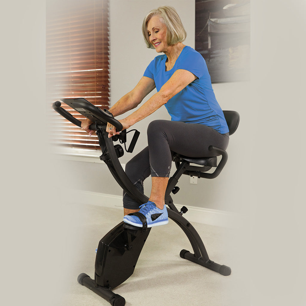 An older woman exercising on a Slim Cycle