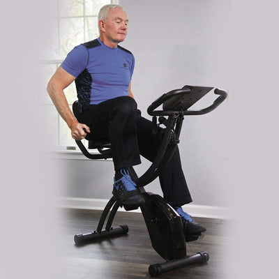 Slim Cycle man exercising on the stationary bike