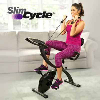 A woman on a Slim Cycle in a living room, product name in top left corner