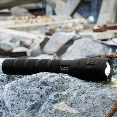Atomic Beam Texas Flashlight on top of rocks lifestyle image from BulbHead