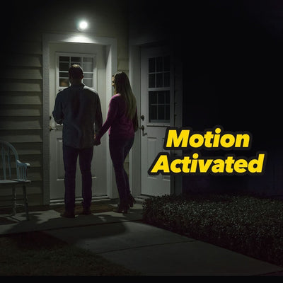 Deluxe Atomic Angel Motion Activated Cordless LED Light couple at the door, light is on motion activated