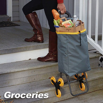 Deluxe Climb Cart Stair Climbing Folding Cart lady pulling cart filled with groceries up the stairs