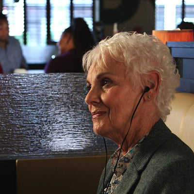 Deluxe Magic Ear used by woman in a restaurant
