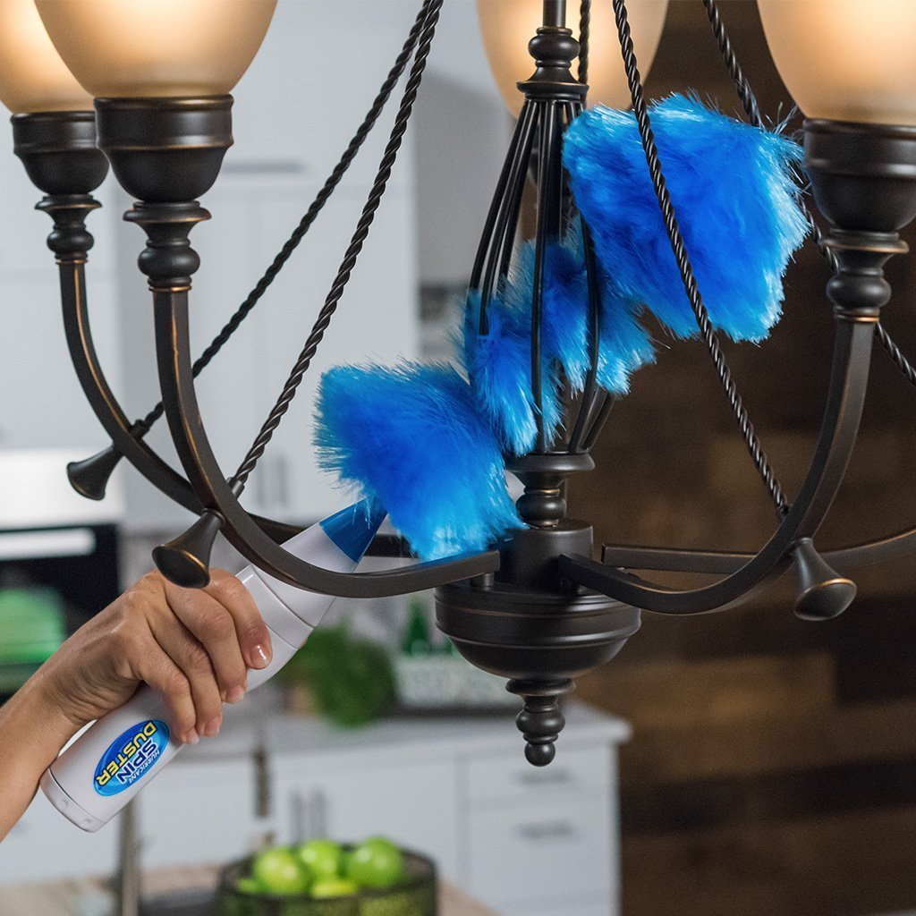 Hurricane Spin Duster Motorized Dust Wand in use on chandelier