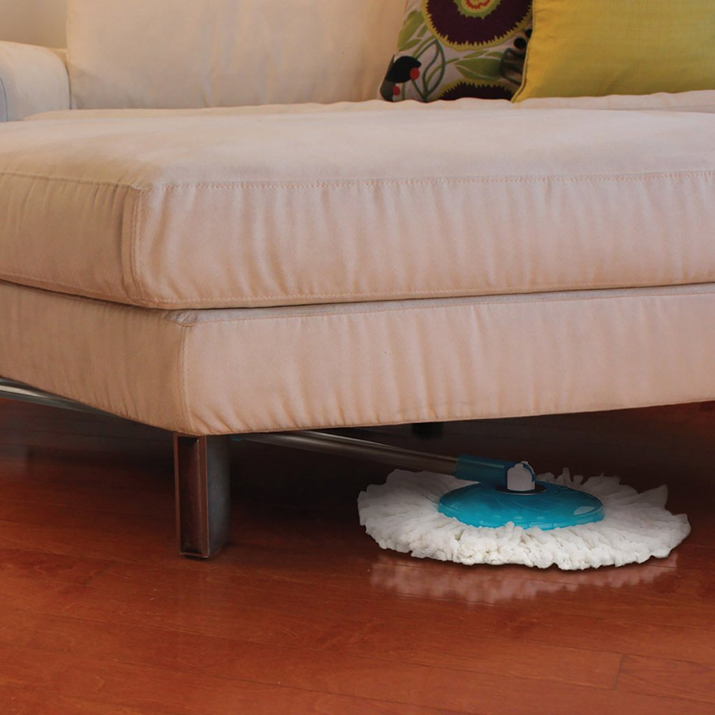 Hurricane Spin Mop in use under a couch