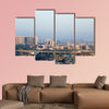 Noida Delhi cityscape with skyscrapers, small houses and metro multi panel canvas wall art