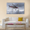 A coastguard helicopter dropping off mountain rescue team members multi panel canvas wall art