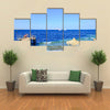 Visitors at snorkelling in the sea during the surf Multi panel canvas wall art