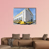 DHL delivery vans at depot multi panel canvas wall art