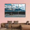 The Athabasca river flows by the Canadian rocky mountains wall art