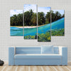 Beach, coconuts trees and school of fish in coral, Panama Multi panel canvas wall art