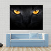 Muzzle a cat on a black background Multi panel canvas wall art