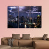 Lightning storm over city in purple light multi panel canvas wall art