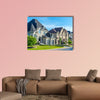 Luxury house in Montreal, Canada against blue sky multi panel canvas wall art