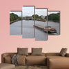 A barge on a canal moving towards a canal lock multi panel canvas wall art