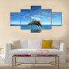 Two Beautiful Dolphins jumping on sea multi panel canvas wall art