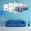 A Beautiful Winter Landscape With Snow Covered Trees Multi Panel Canvas Wall Art