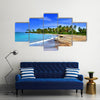 Jamaica. A national boat on sandy coast of a bay Multi panel canvas wall art