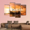 Local boat on the beach at sunset time, Bali, Indonesia multi panel canvas wall art