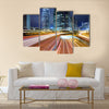 Traffic in city at night Multi Panel Canvas Wall Art