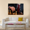 Canvas of a businessman in dark suit playing chess multi panel canvas wall art