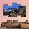 Bald eagle soaring over rocky peaks with a bright blue sky canvas wall art