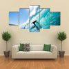 Beautiful view of Surfer on Blue Ocean Wave Multi panel canvas wall art