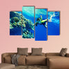 Group of coral fish in blue water Scuba diver Multi panel canvas wall art