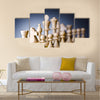 Concept of chess game with pieces multi panel canvas wall art