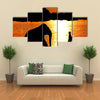 Elephant Training in Thailand During Sunset Silhouetted Multi Panel Canvas Wall Art