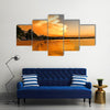 Spectacular-looking clouds at sunset Multi panel canvas wall art