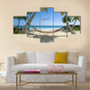 Exotic travel composition with a flying plane, a tropical beach Multi panel canvas wall art