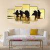 Soldiers run in army uniform Multi Panel Canvas Wall Art