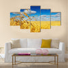 Ripe wheat ears over wheat field Multi panel canvas wall art