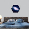 Glowing galaxy against black space and stars hexagonal canvas wall art